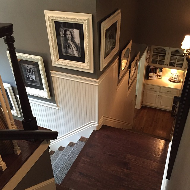 A bird's eye view! Love this wainscoting that my hubby installed for me! It's the perfect fit for this staircase and these antique frames make my    ❤   swoon!