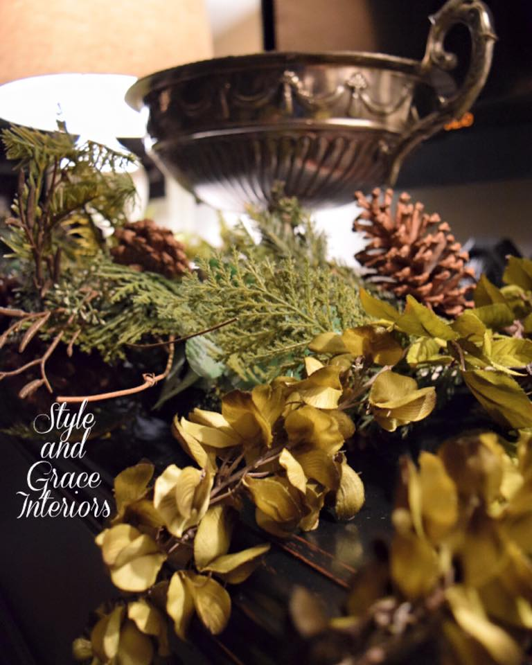 I love that I don't have to take down all my Christmas decor! This winter garland adds the perfect amount of warmth to this buffet in our family room!