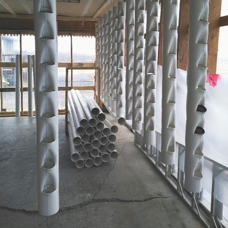 The clear walls and the making of the holes in the PVC pipes and finally connecting the PVC pipes.