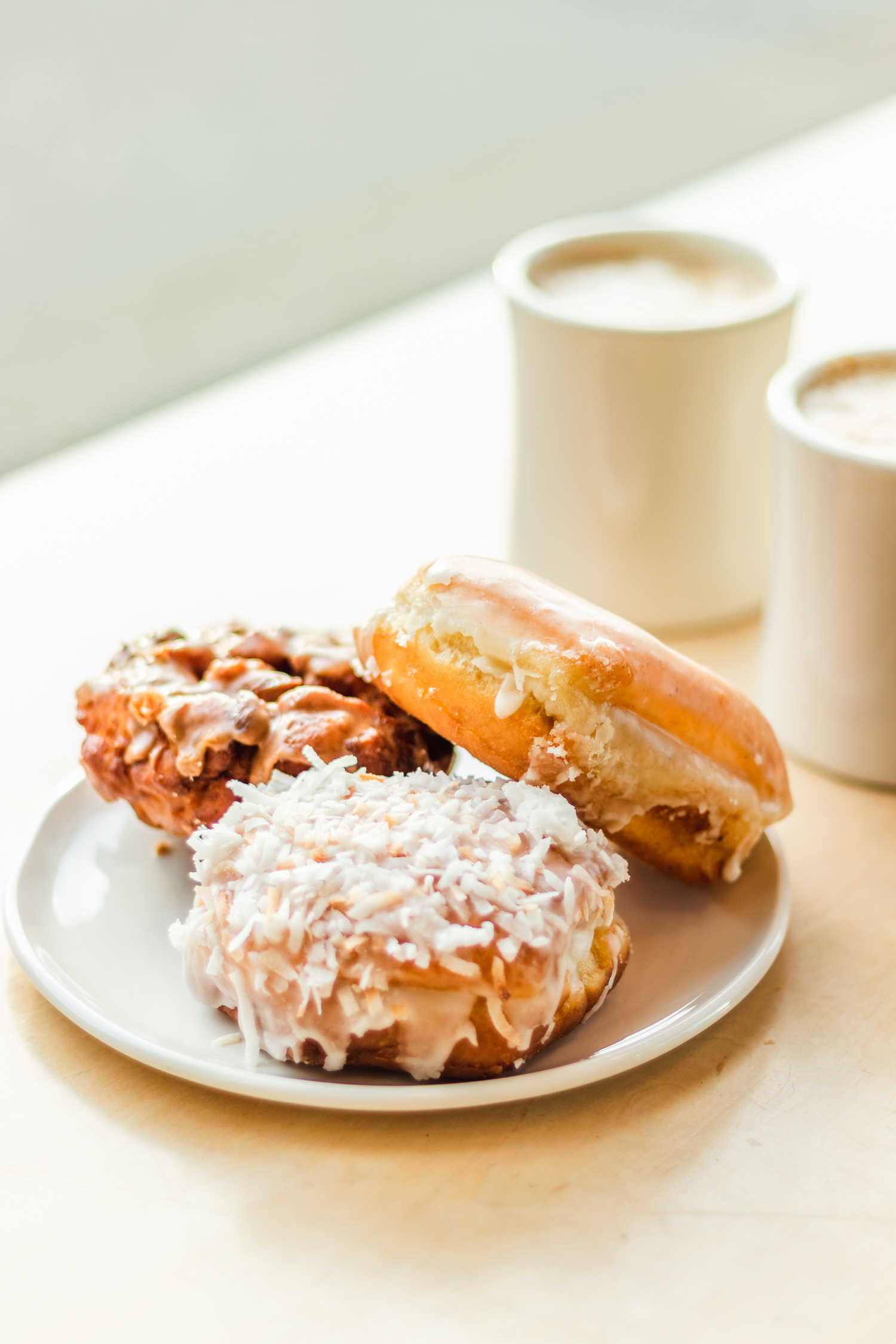 Apple Fritter, Coconut Cream & Vanilla Donuts at Cartems