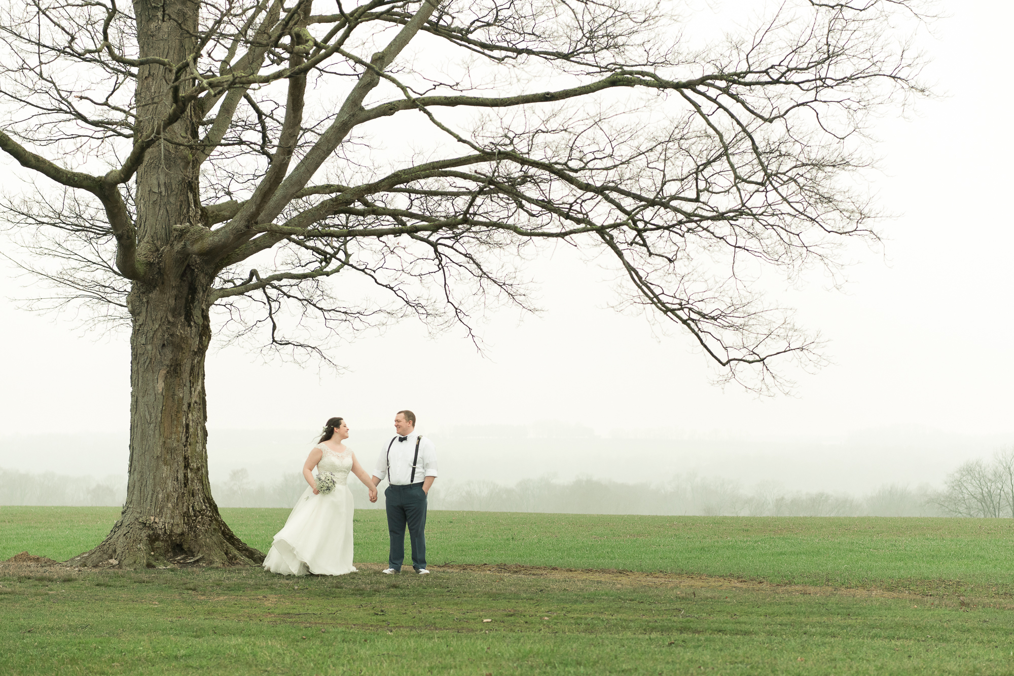 Well, it did rain, but as we left the church it tapered off, and by the time we reached the reception venue all that was left was this beautiful mist on the horizon which added a dreamy, romantic quality to these outdoor shots. The setting fit our couple - calm and serene. Throughout the day, Molly and Mackenzie exuded calm (not always a common occurrence at weddings!), and they were up for anything we asked of them, happily enjoying the day they became husband and wife.  Look for more from Molly & Mackenzie's wedding; we'll be recapping more on the day and posting many more images very soon!