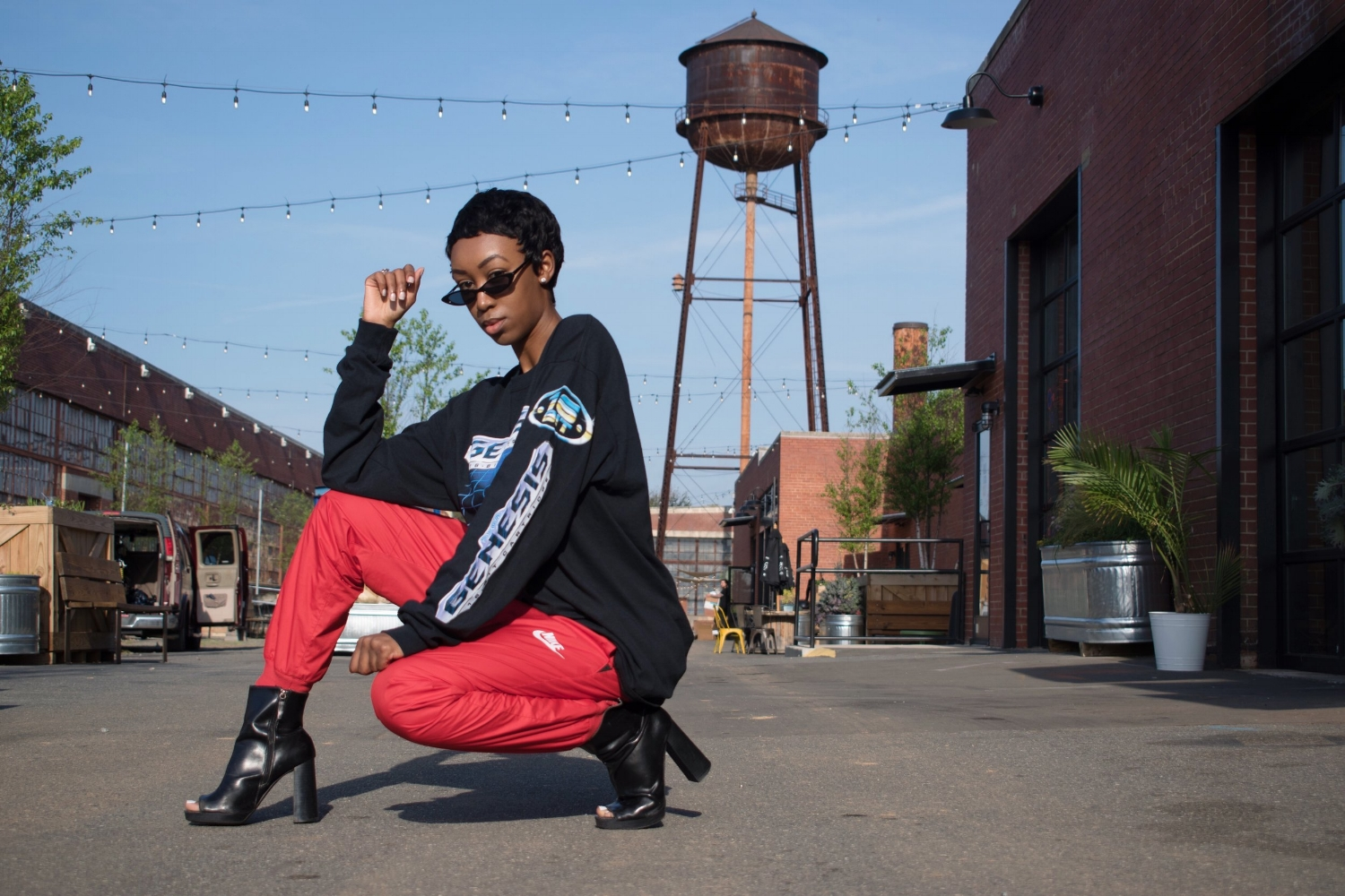 Simone Suber  of  MissSuber.com  is wearing a  Forever21  Mens top,  NIKE  Mens pants,  ZARA  shoes,  ASOS  sunglasses. Photography by  Krishanni Smith .