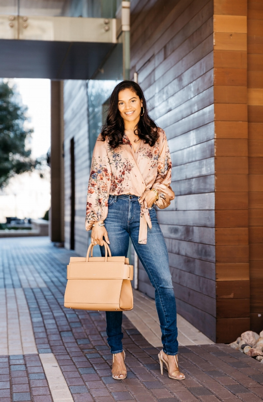 Lauren Caldwell  is wearing  Citizens of Humanity  jeans, a  Zara  bodysuit, and a  Givenchy  purse.