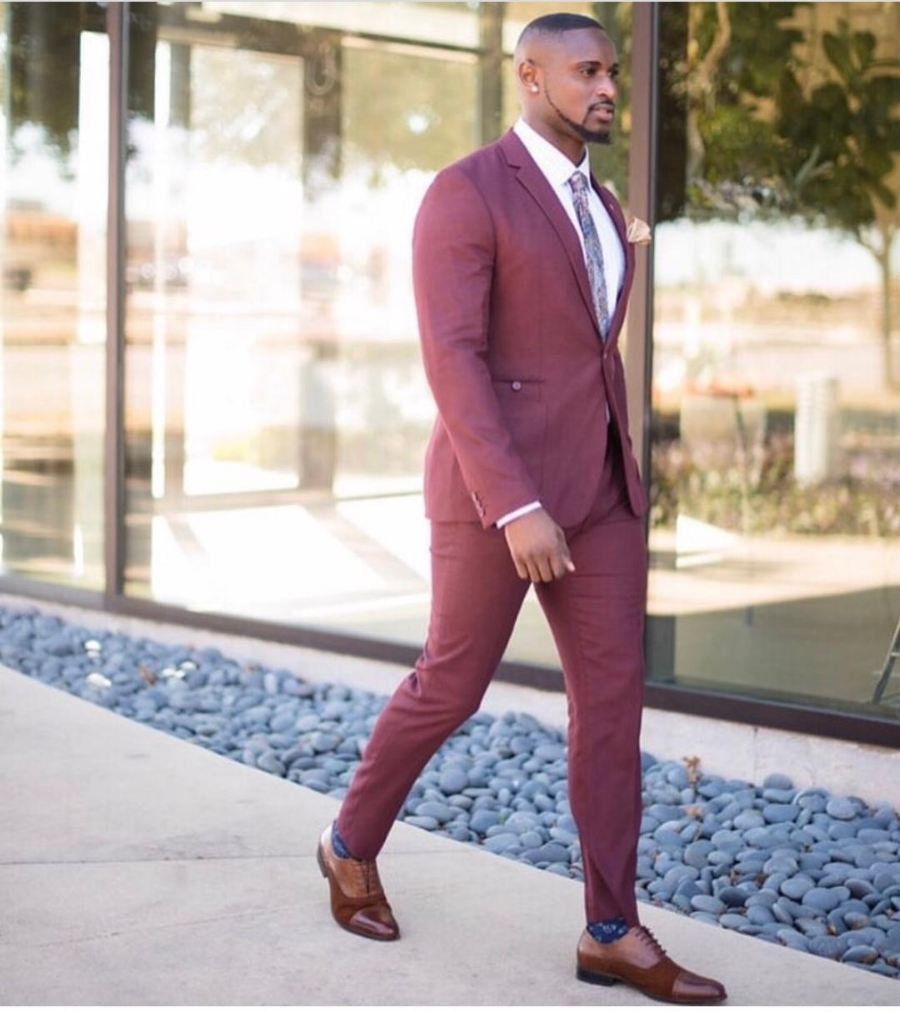 Sage Raphael  is wearing a  Topman  suit,  Aldo  shoes, a  Men's Warehouse  shirt and a tie from  Macy's . Photography by  John Marcus .