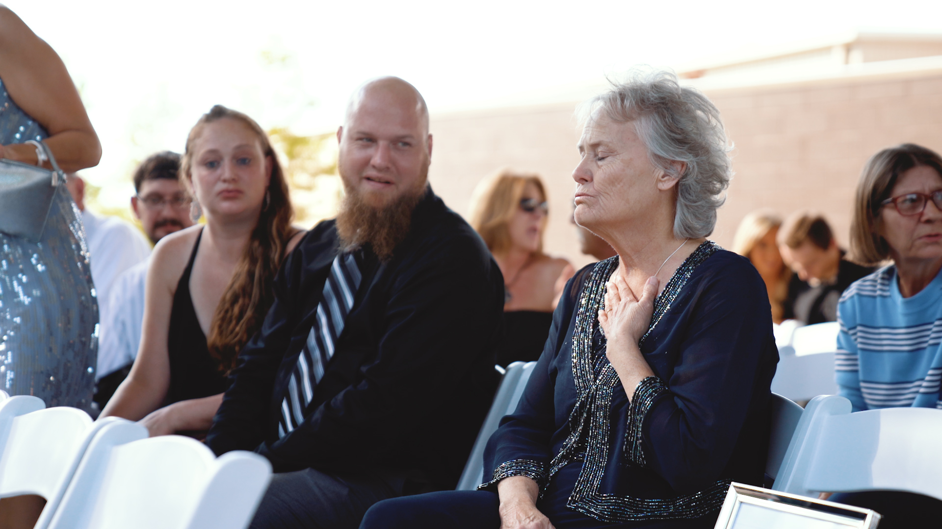 lady exhaling with emotion at wedding