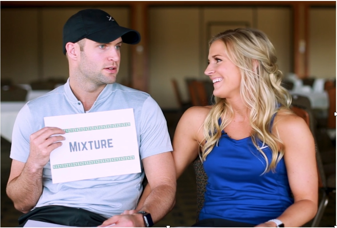 couple smiling and answering questions