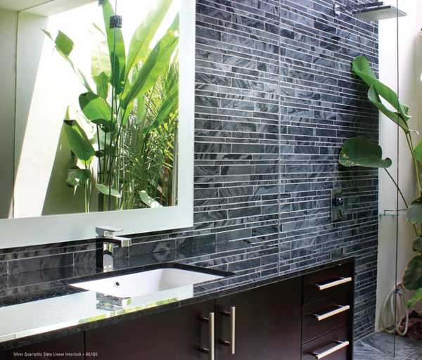 Clean structured lines create order: the dark tiles project a dramatic tone.