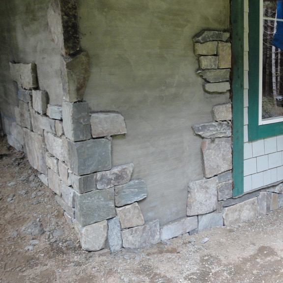 Stonemason skills, in high demand, are easier because stone pieces are now thinner, making real stone a viable option in a competitive market.