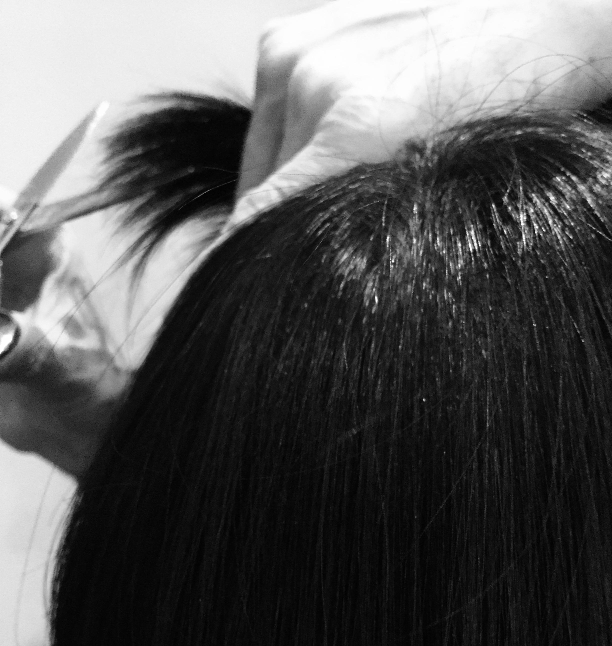 A ladies hair being cut