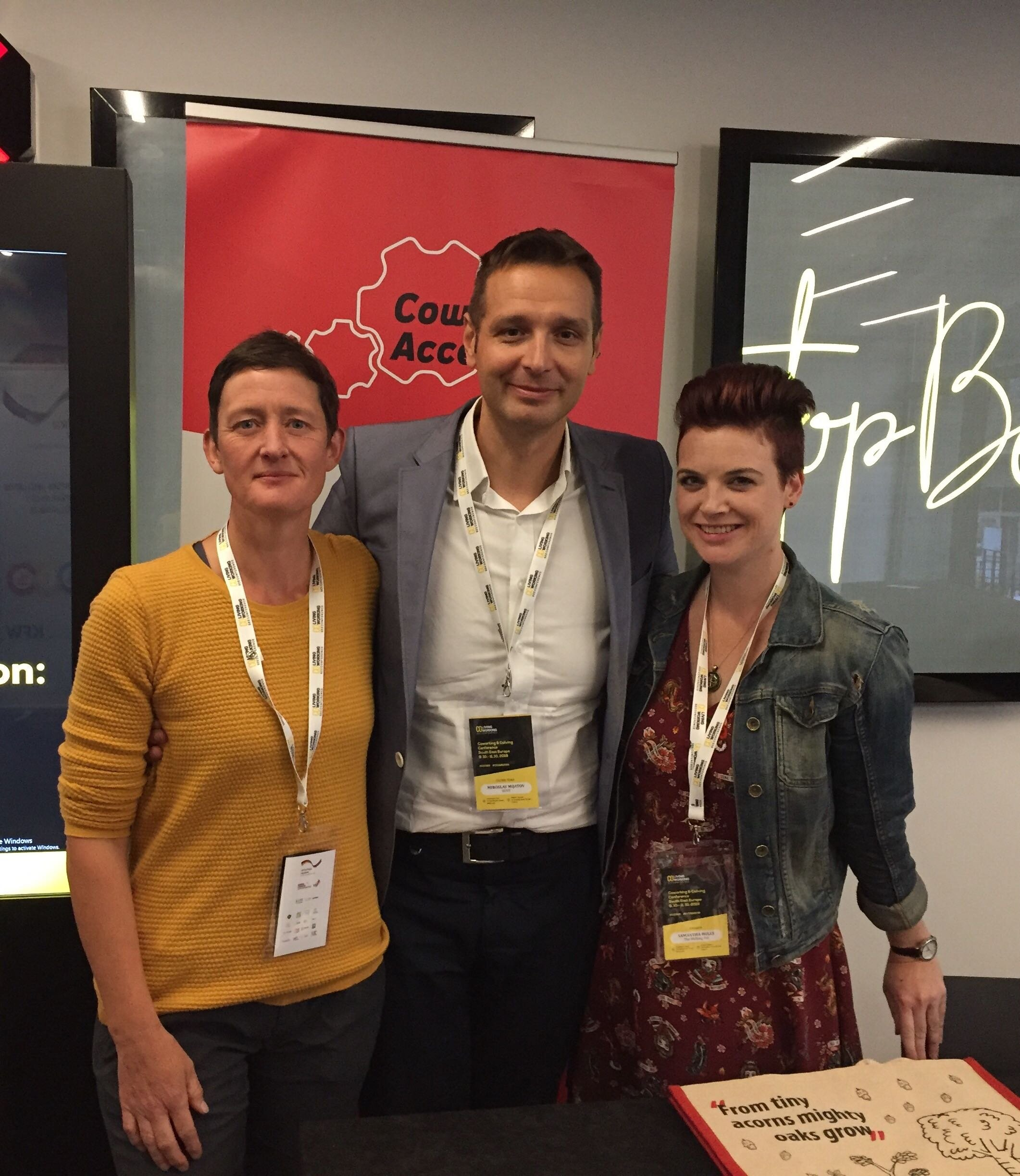 A trio of coworking legends - Claire (left) and Sam (right) with the creator and organiser of the very first CCCSEE, Misha Mijatov (middle).