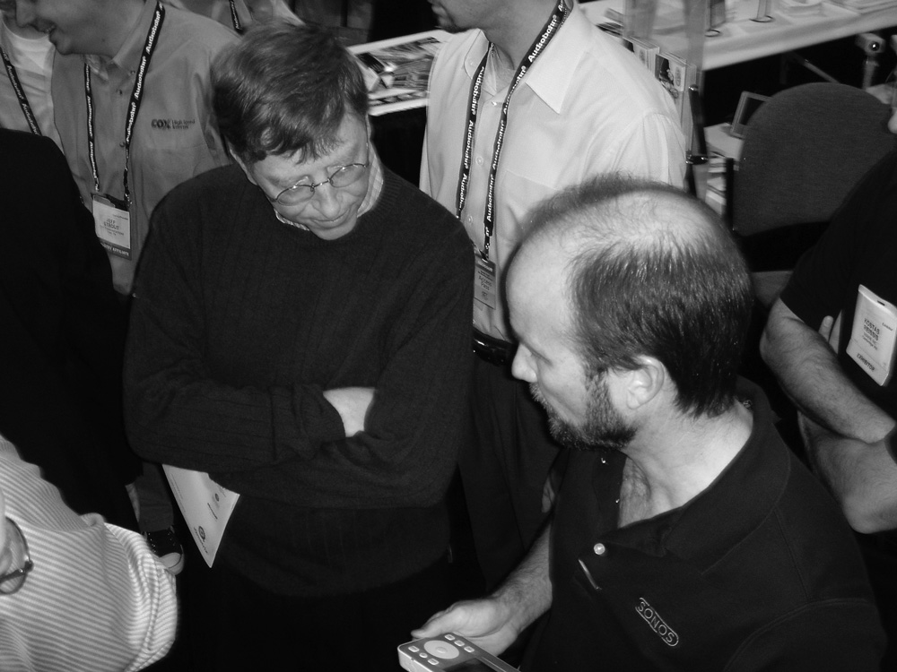 Tom Cullen gives Bill Gates one of the first public demos of Sonos' ZP100 and CR100 at CES in January 2005.