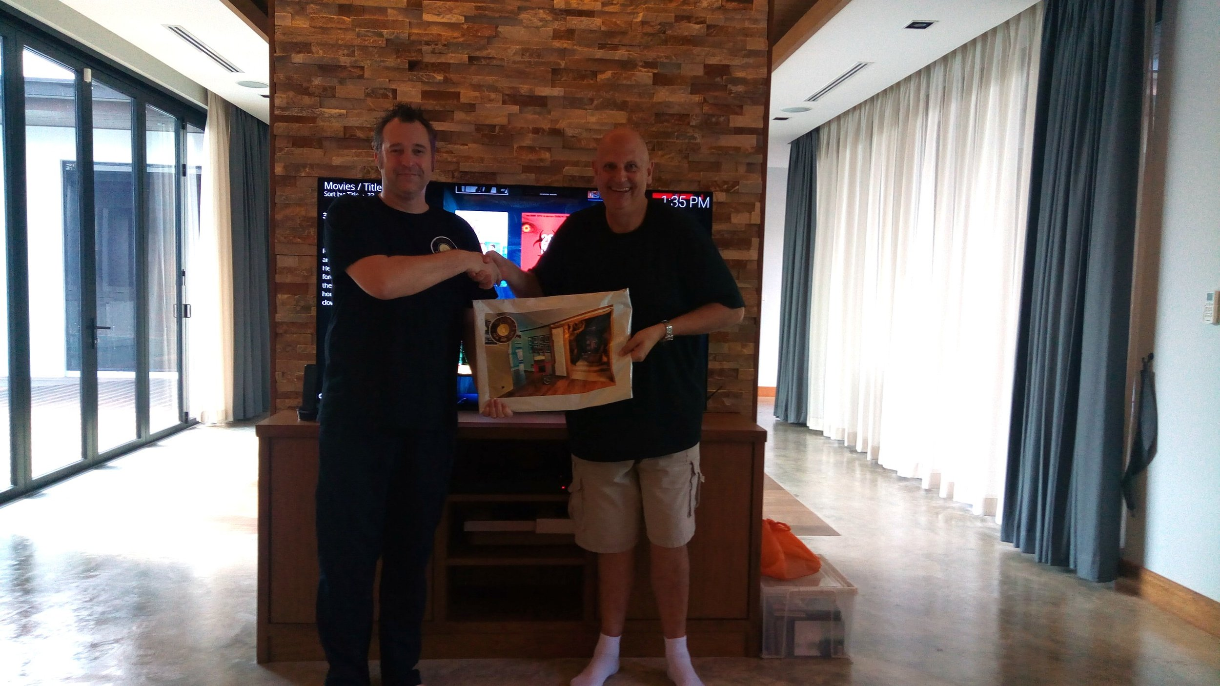 H3 Digital MD Ben Hobbs presents Gerry with his Smart Home handover pack.