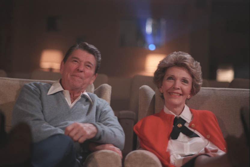 President Reagan and his wife Nancy enjoy a screening in the Whitehouse Cinema.