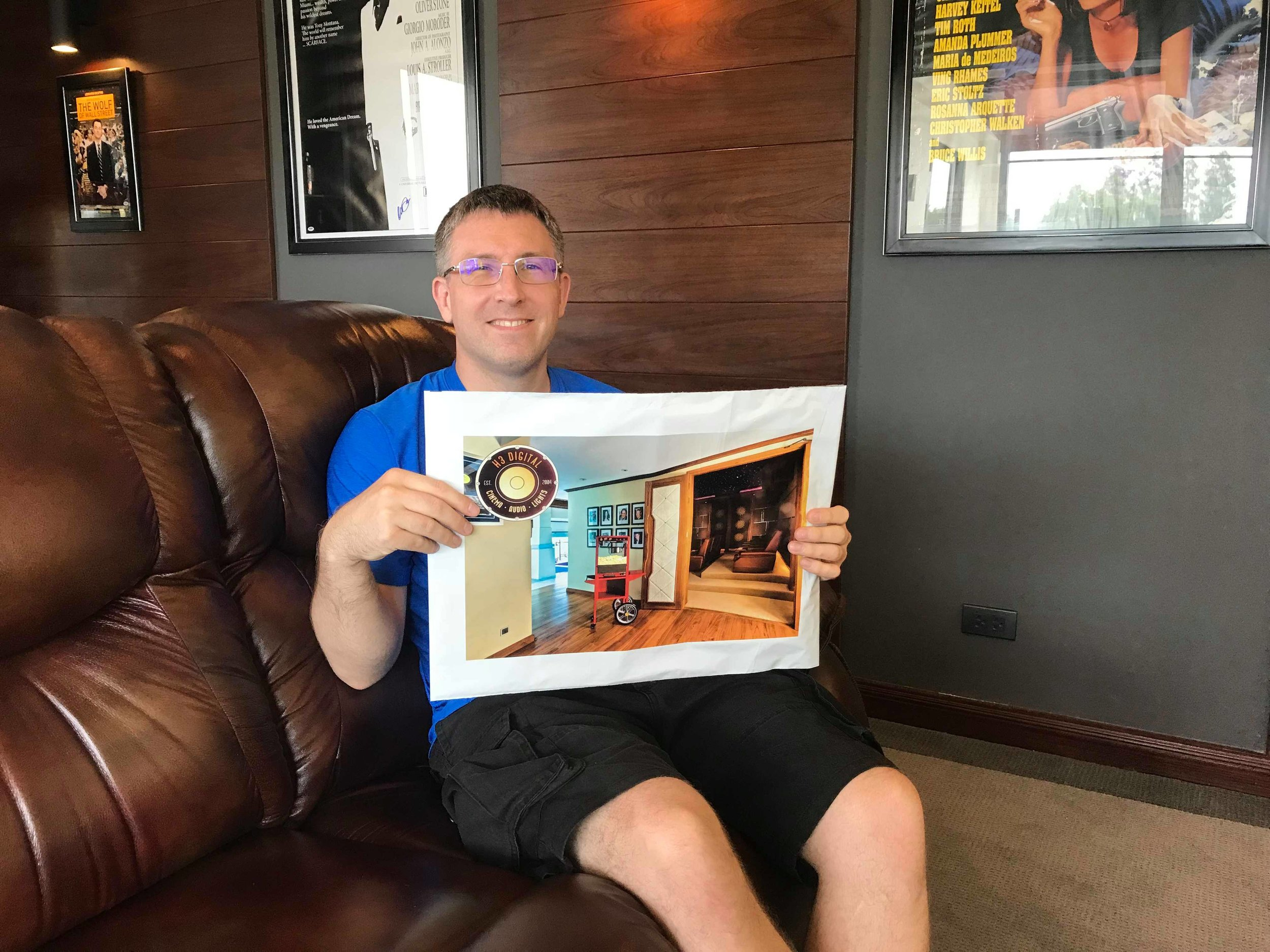 Hans relaxing in his home cinema with a H3 Handover Pack.