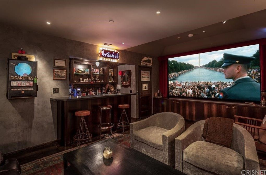 The bedroom also features a full cinema design and mini-bar.