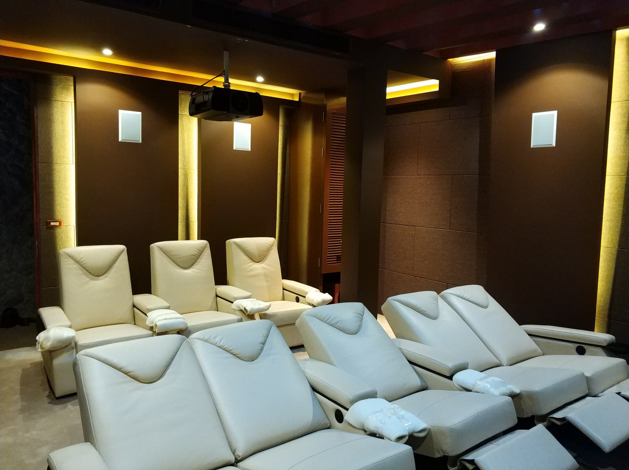 Our custom home cinema motorised recliners in premium leather in Ferrari White