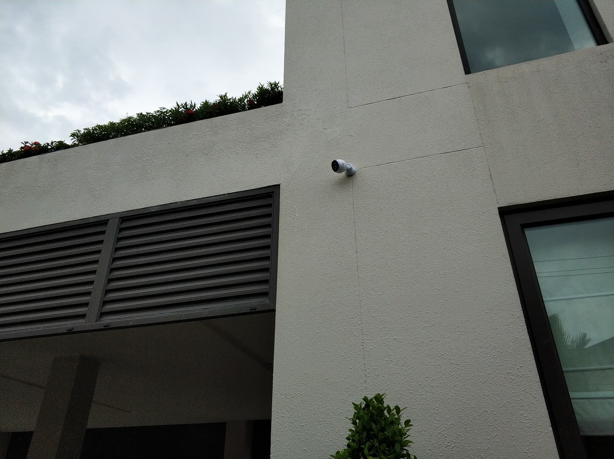 Ubiquiti CCTV Camera mounted to external wall.