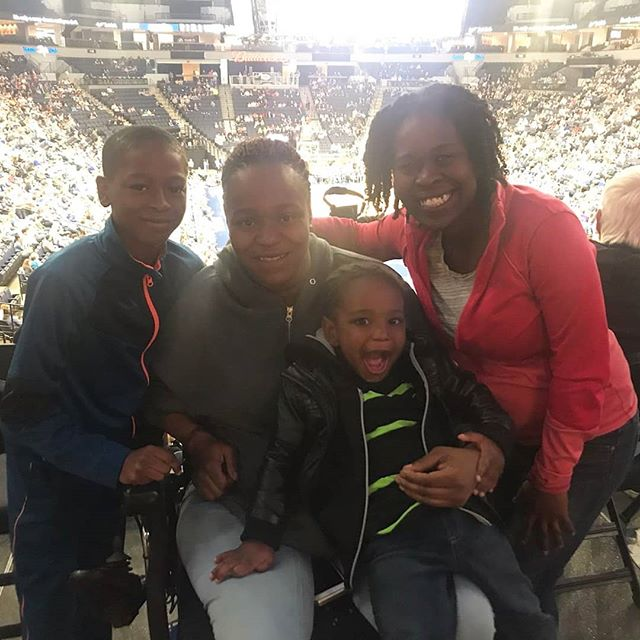 Kinship staff at a Lynx game with a Kinship family