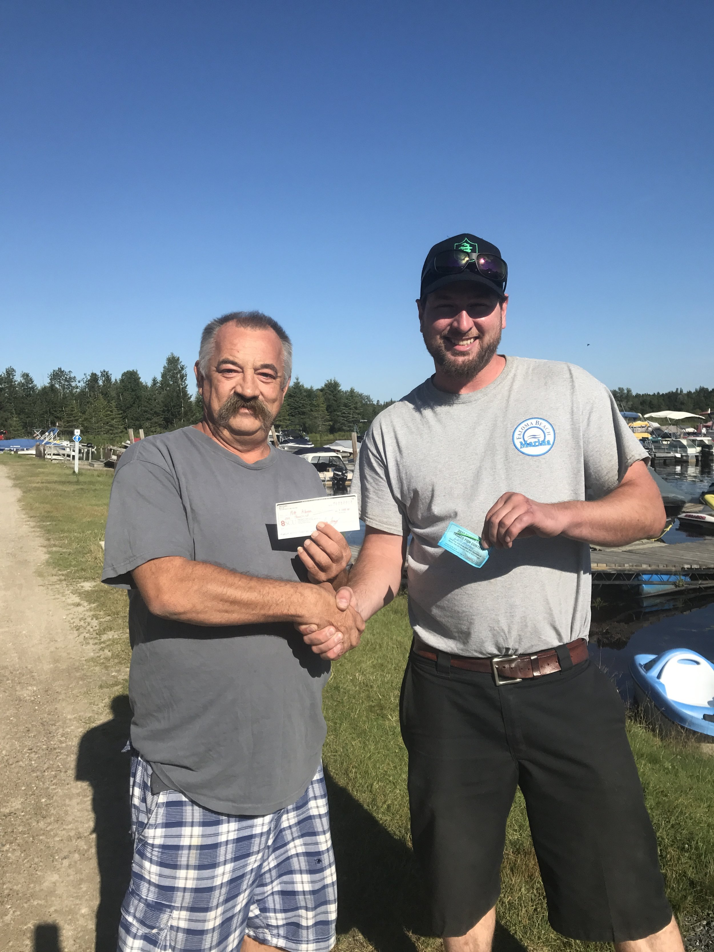 Congrats to Pete Who caught the first Tagged Fish on Falcon Lake! Pete won a $1000.00 for catching the pike with tag #2 in it. Pete caught this fish from shore near the Falcon Lake Winter Fish-Off derby site. there's still 5 tagged fish worth a total of $9000.00 swimming in Falcon Lake as we Speak so get out there and try to catch one!