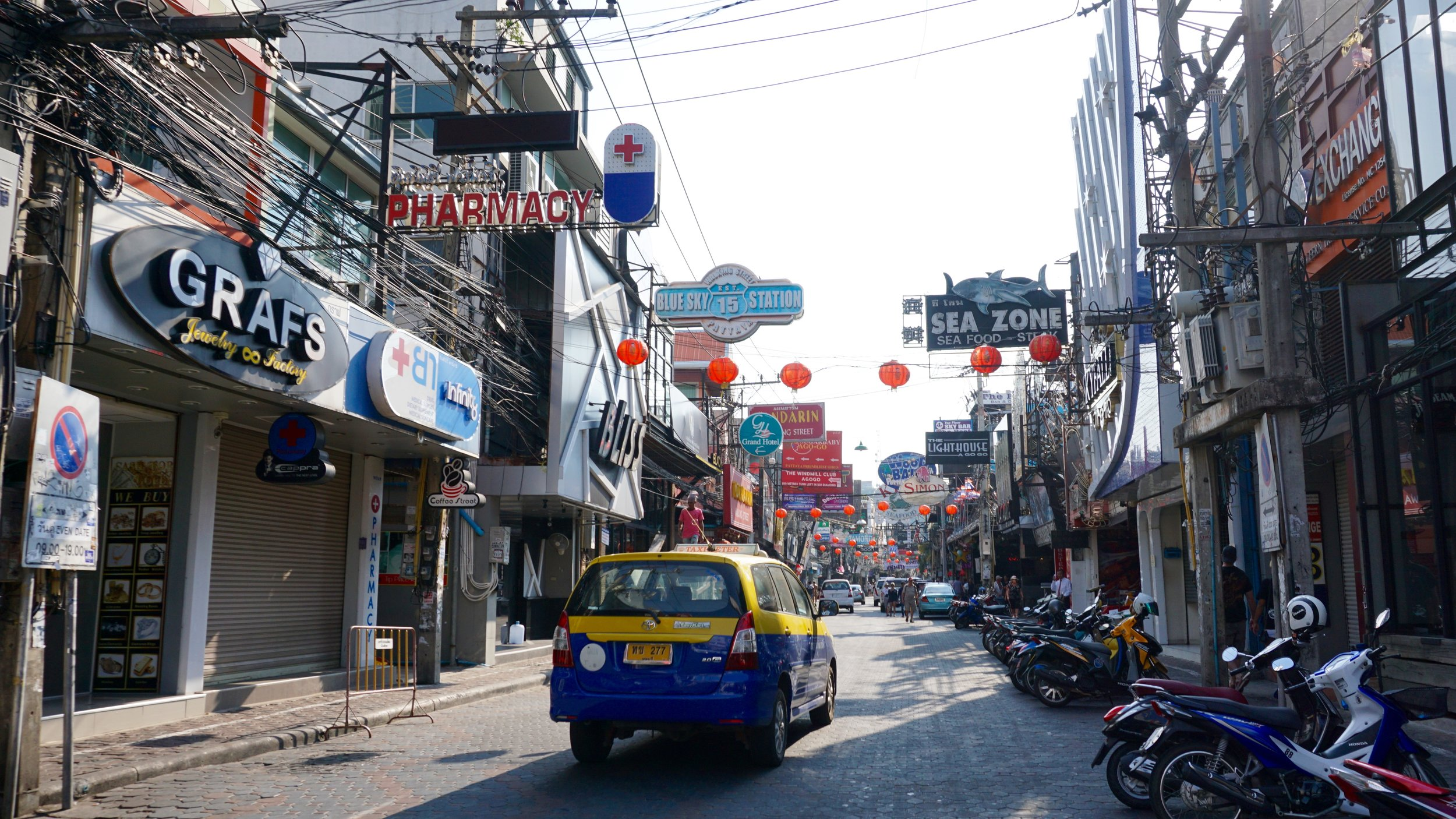 Walking Street in downtown Pattaya during the day.