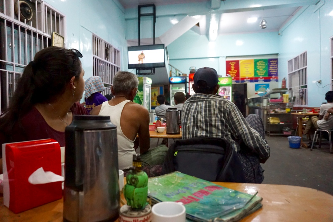At night in Mandalay, everyone flocks to cafes playing action movies while sipping Burmese tea.