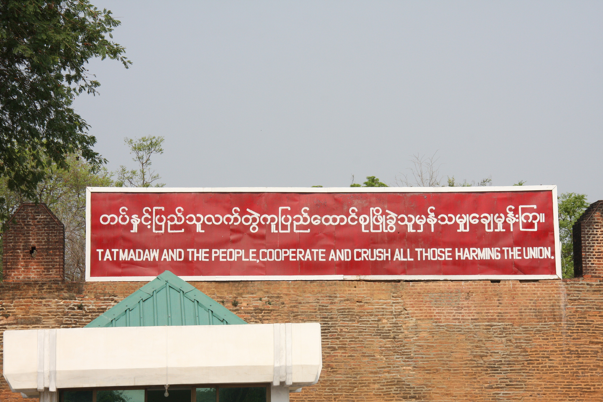 Sign hung by the military government in the city of Mandalay. Credit: Matthew Goulding / Flickr