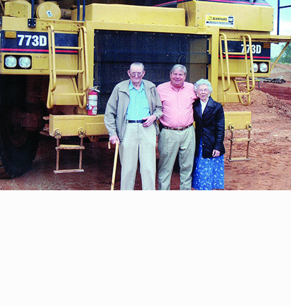 Ladson Morgan and Stewart Johnson Sr. in front of a Cat 773D