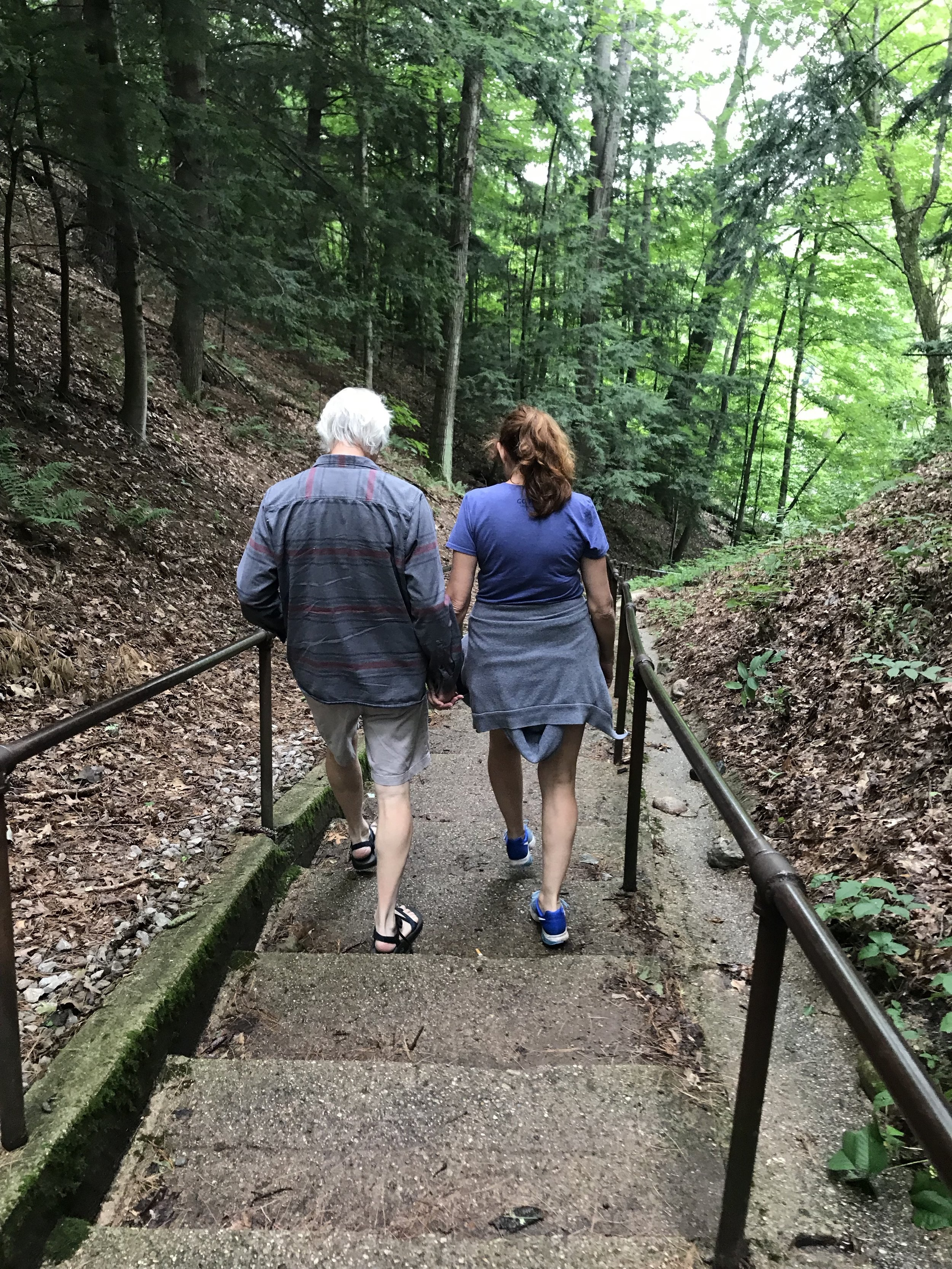 Binnie and Bill on a short hike at Tippy Dam in Wellston Michigan.