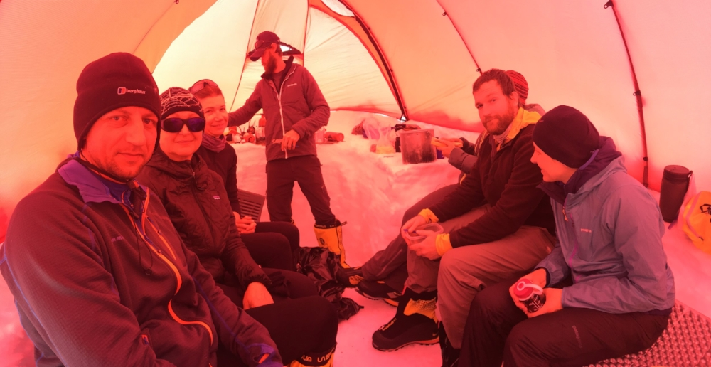Staying warm in a cook-tent on Denali, while a storm is blazing outside, 2016.