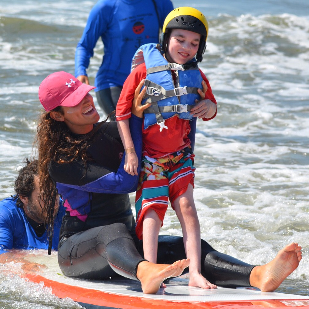 Daniel Cooke-  A Tommy Brull Foundation recipient enjoying The Tommy Brull Adaptive Surf Camp at Camp Anchor.