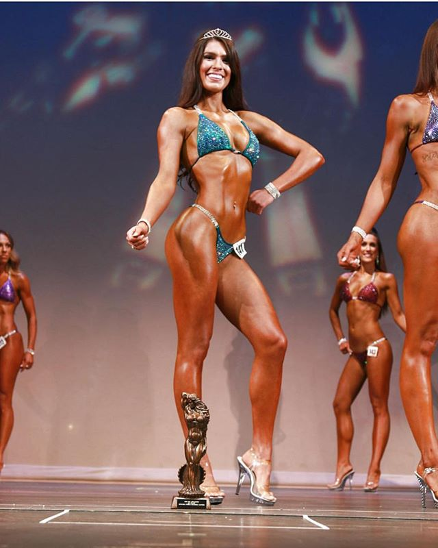 SO proud of this girl! @jpaigeefit 1st in Novice and 2nd in Open. Seeing our girls shine on stage is pretty much my most favorite thing ever!!!!! Happy Friday Fit Chicks! 💕 . . . Coached by @jloprofit  Suit - JLK from the Rental Collection (link in bio!)