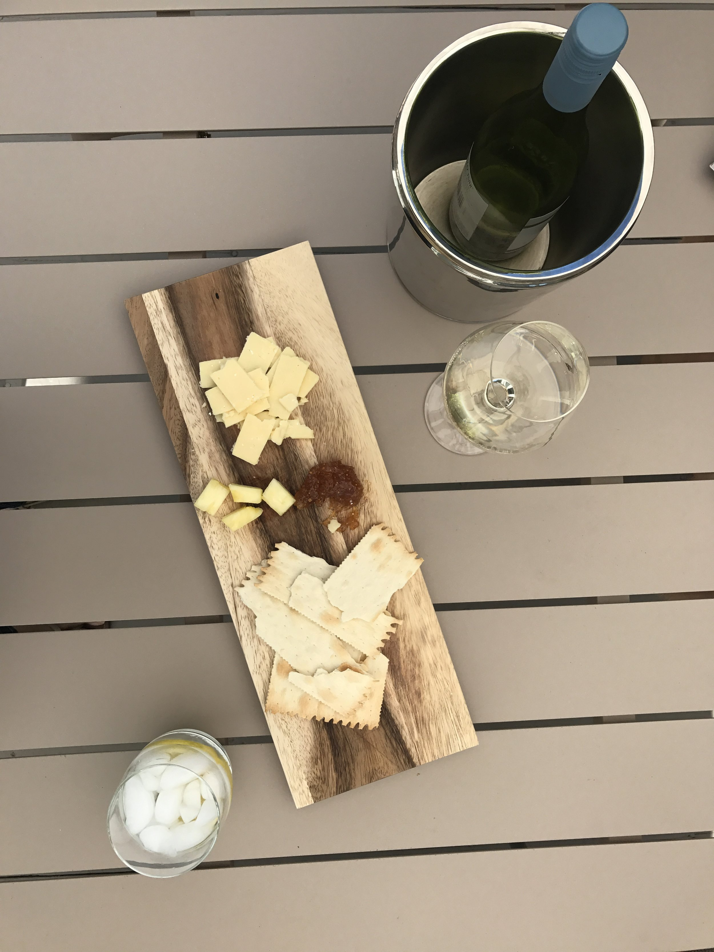 Sunday afternoon cheese platter =) With white wine for my Beautiful Husband and a lemon water for me!