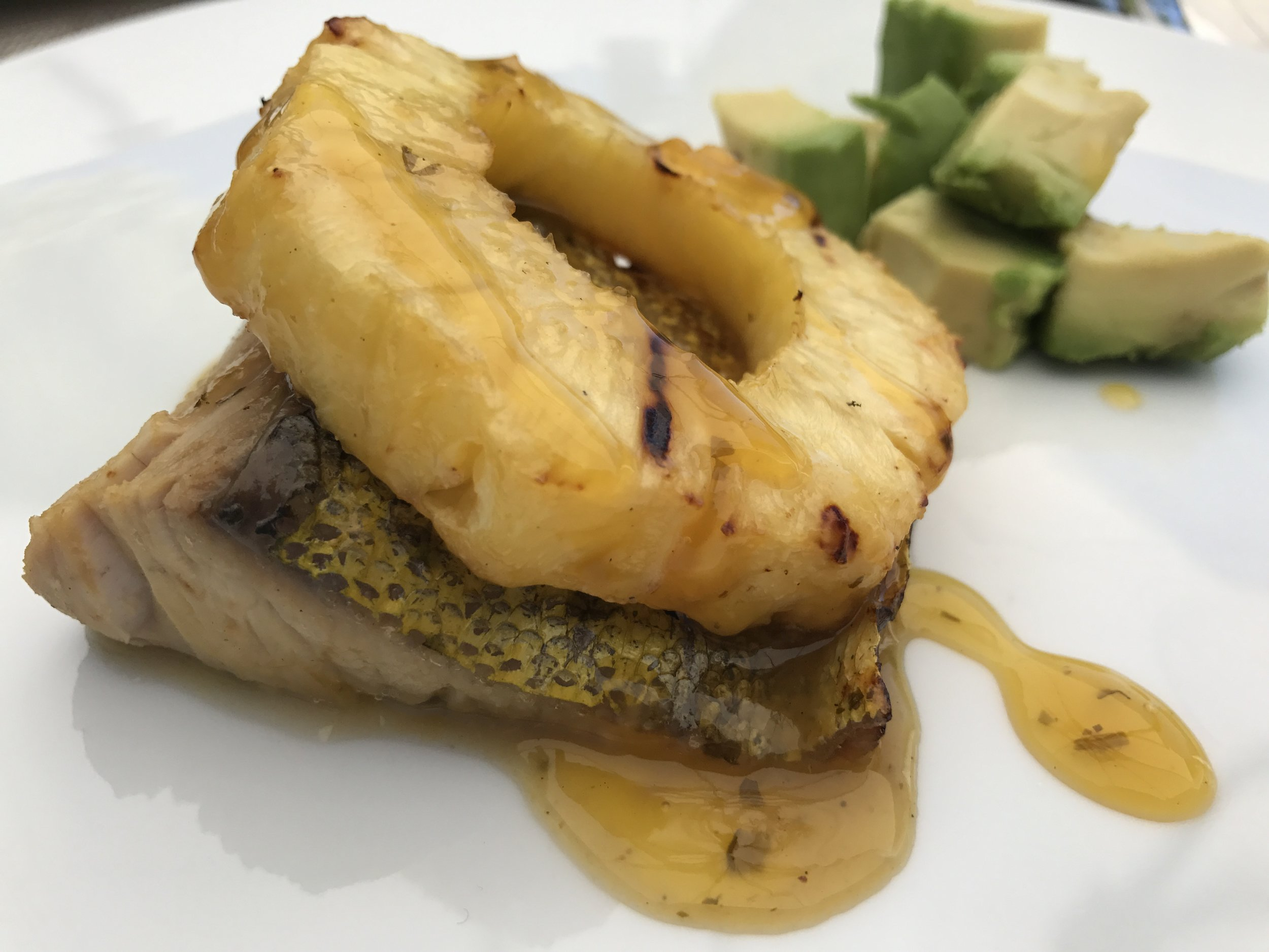 Glorious dinner prepared by my Husband on Sunday night! Grilled mahi-mahi with grilled pineapple, all drizzled with a decadent mango sauce. Loved it! It reminded us of our honeymoon in Bora Bora =)