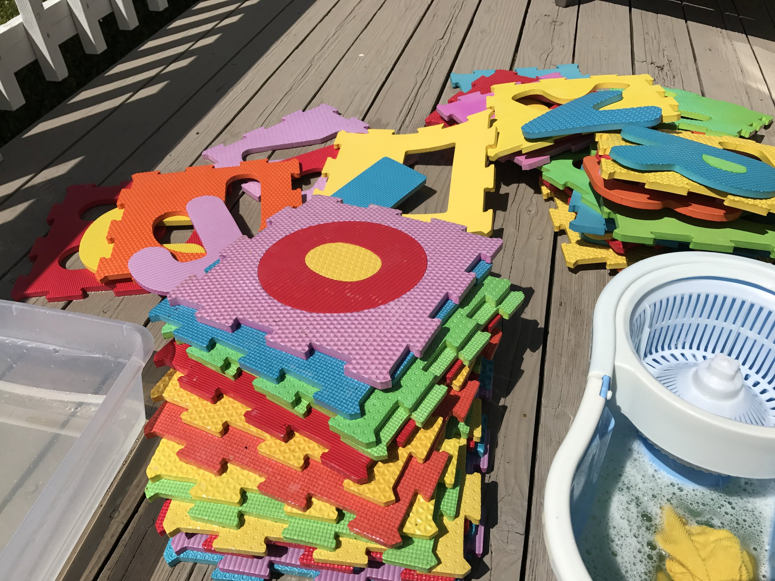 I took some time out this weekend to wash down Amelia's play mats - I scrubbed each with Mr. Clean and hot water, and then dunked them in cold water to get rid of the residue. Then left them on the deck to dry in the sun!
