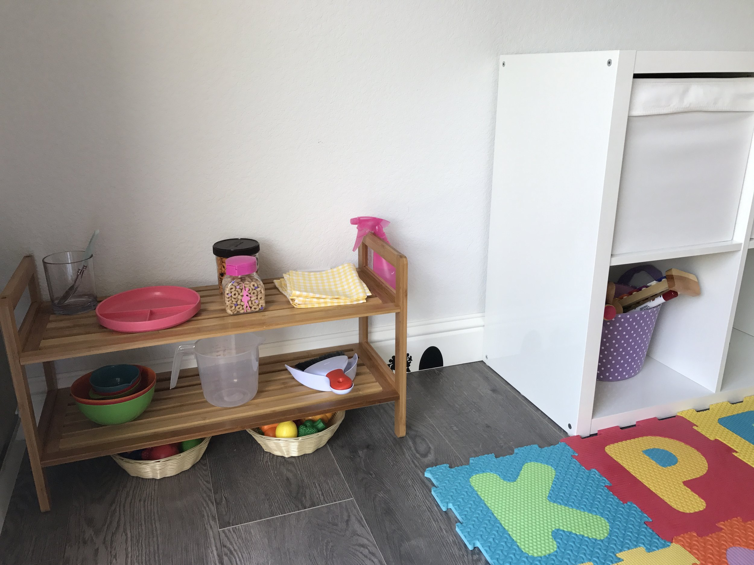 I love how Amelia's little kitchen has turned out! It will evolve with he rover time, but for now it houses some utensils, plate, snacks, napkins, a couple of bowls and some cleaning tools. She doesn't know how to use them yet for thier tru epurpose, but enjoys playing with everything enormously! So excited tow atch her grow!