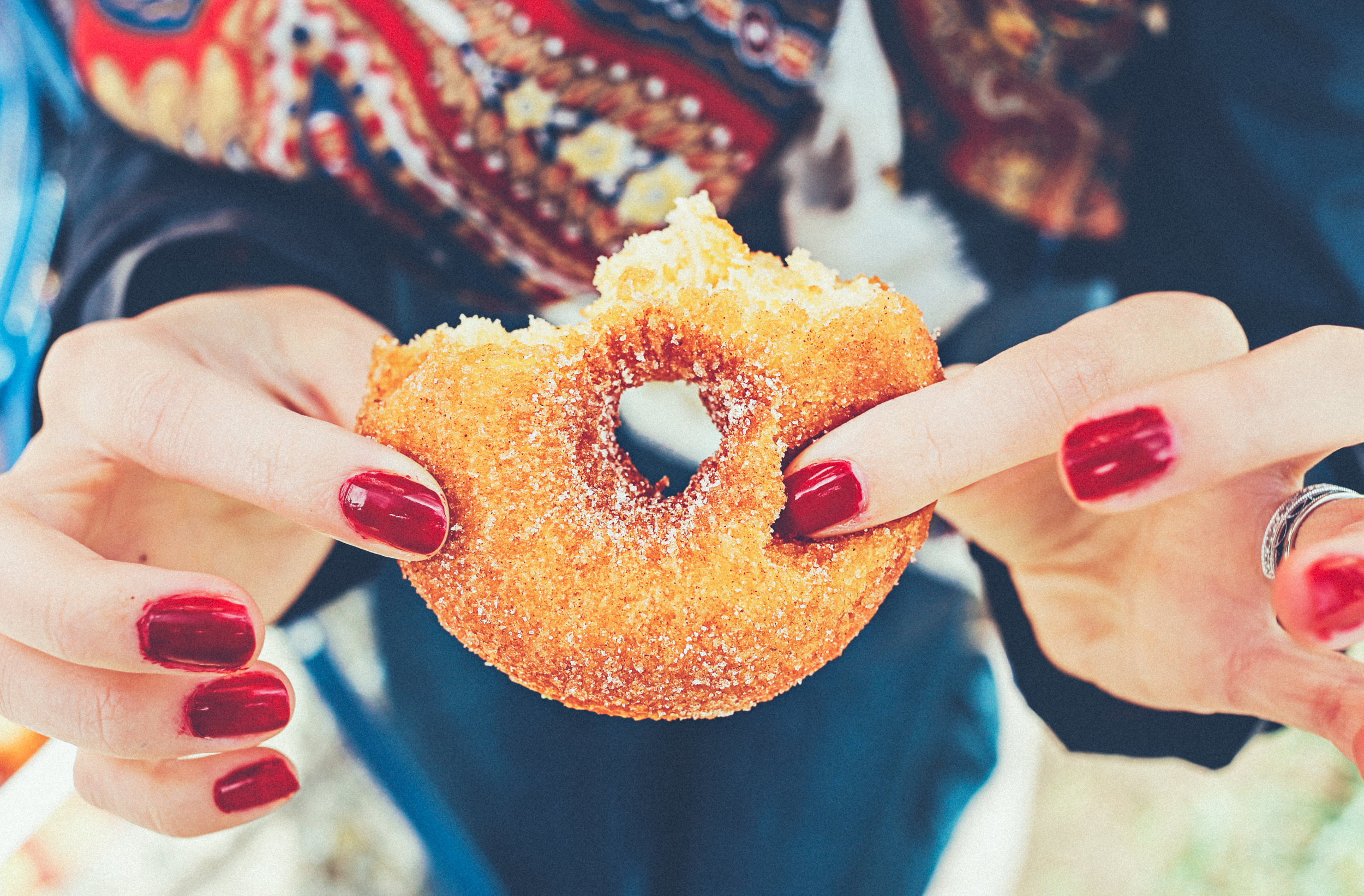 Woman with sugar donut