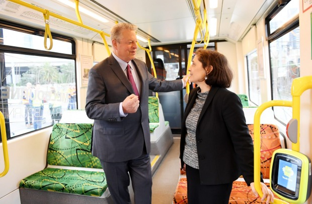 Victorian energy minister Lily d'Ambrosio – pictured on one of Melbourne's soon to be solar-powered trams – says Victoria won't approve a NEG that compromises her state's renewable energy goals. AAP