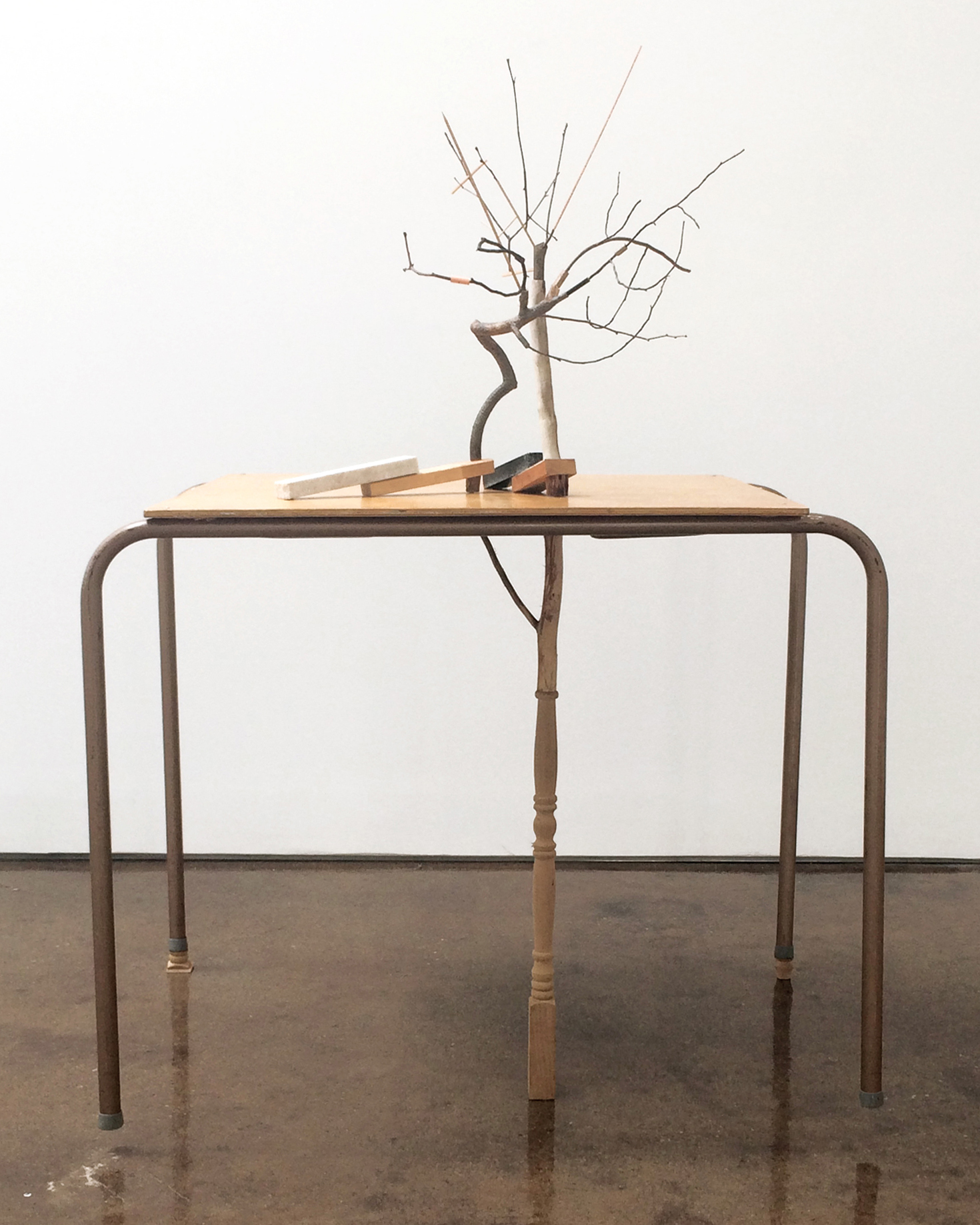 leter arber  2017 twigs, mixed media wood products, marble, granite, table 52 x 37 x 30 inches