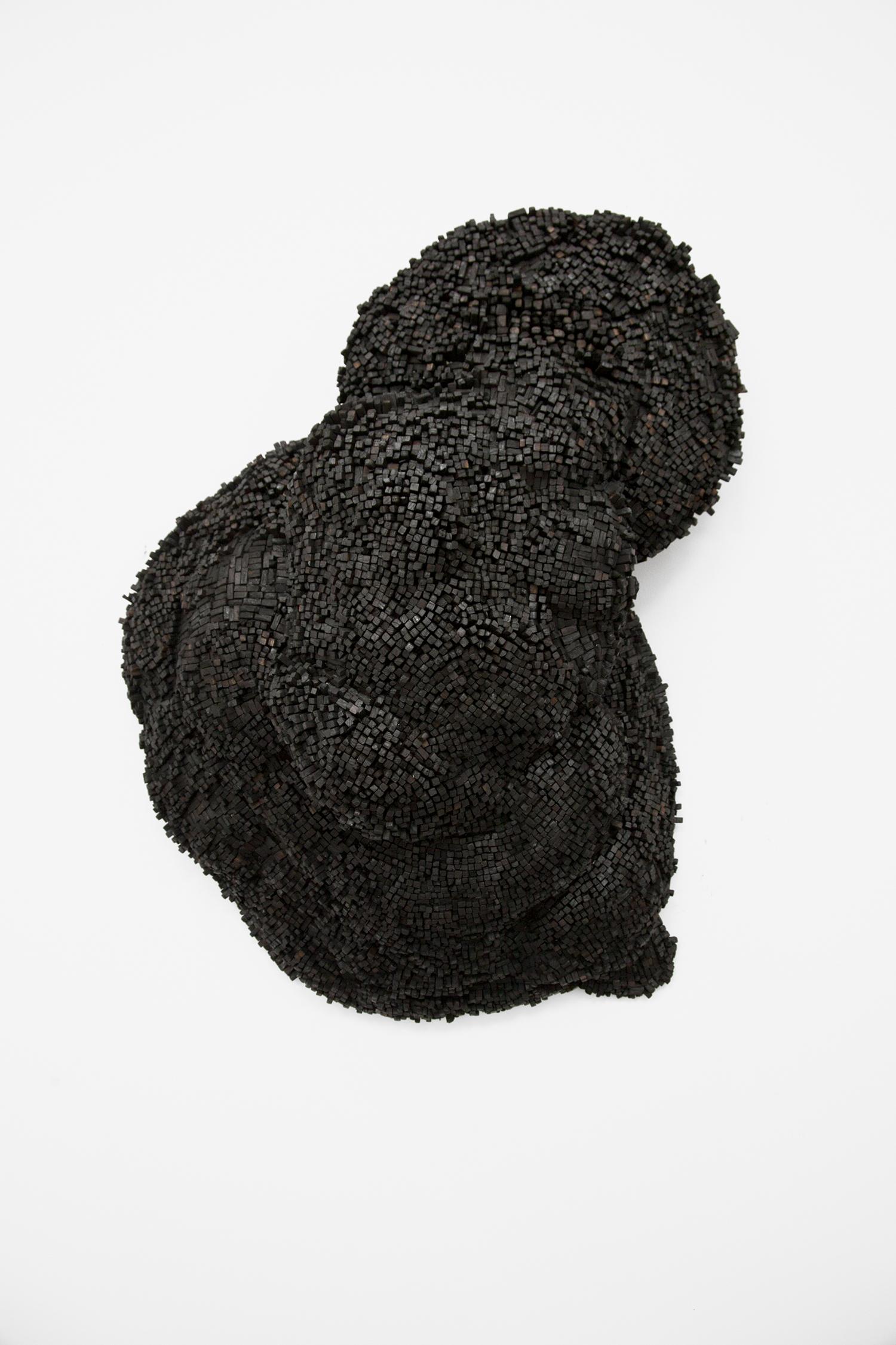 char  2018 charcoal, styrofoam, papier maché  36 x 30 x 11 inches