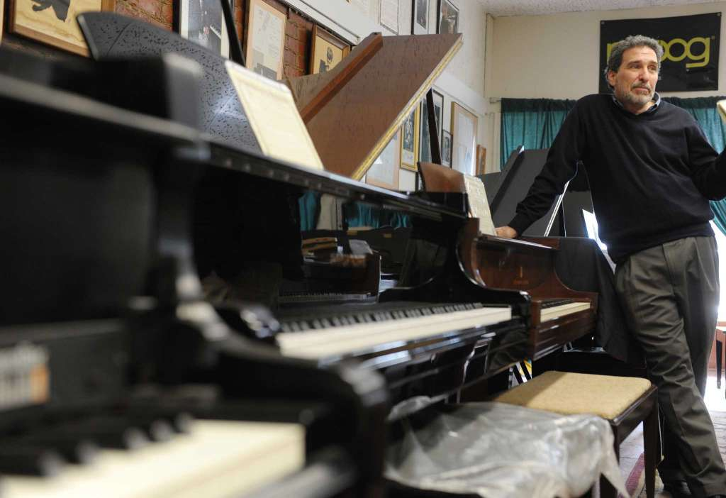 Evan Tublitz, owner of Used Piano Center, talks about his work at his shop on Park Ave. on Tuesday, March 26, 2013 in Mechanicville, NY. (Paul Buckowski / Times Union)