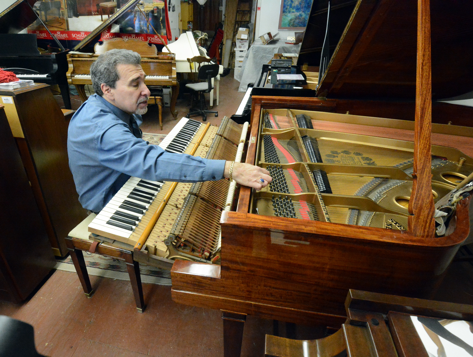 Evan Tublitz working on  Rare Art Case Steinway Grand