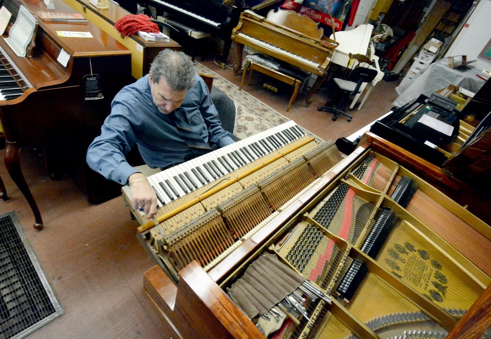 Evan Tublitz regulating Steinway Grand at Used Piano Center.