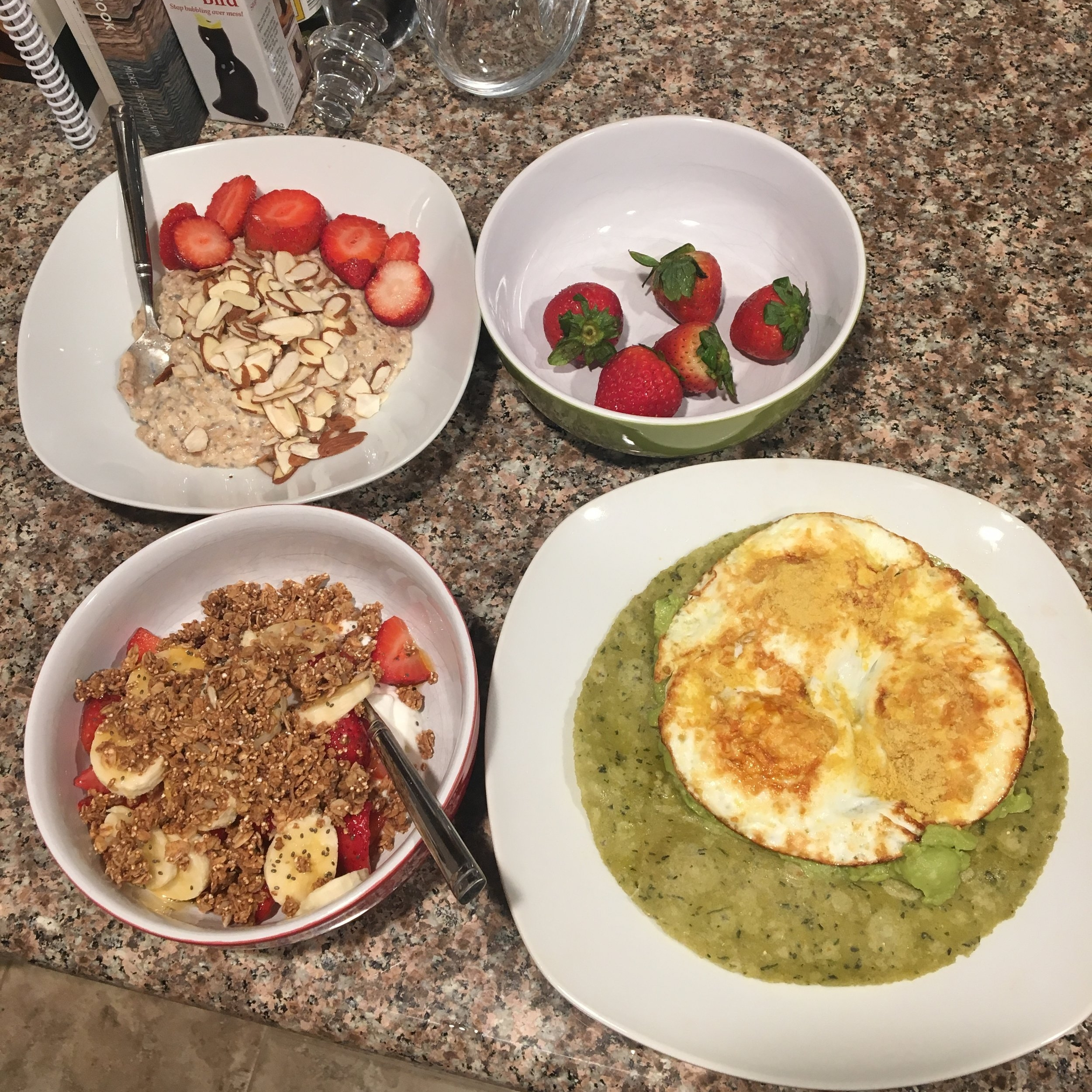 We made breakfast at home to save money and fuel up for an active day ahead. We made protein oats (top left), a greek yogurt parfait (bottom left) and fried eggs on a spinach tortilla with a side of strawberries.