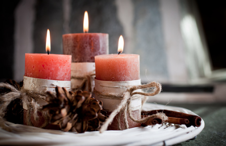 So simple. Get a plate or charger and put three candles on it. Wrap the candles with twine add burlap and then add some pinecones. Beautiful and simple!