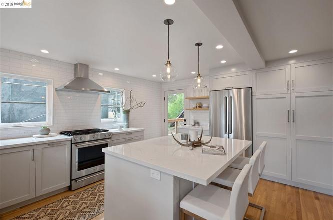 Another view of the Modern White Kitchen at the A Frame home in Oakland California. E Design available at www.dinamariejoy.co