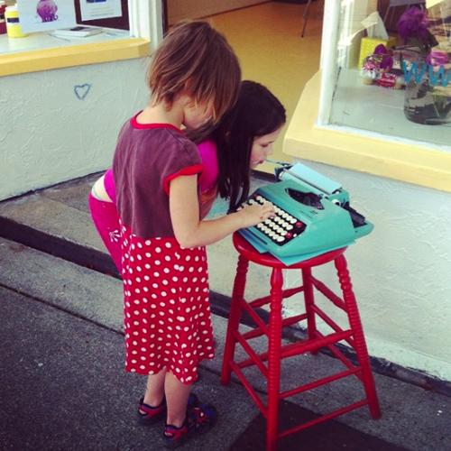 Children looking at typewriter