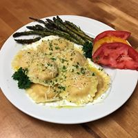 Lobster Ravioli with house-made Alfredo and a glass of wine? A hole in one!