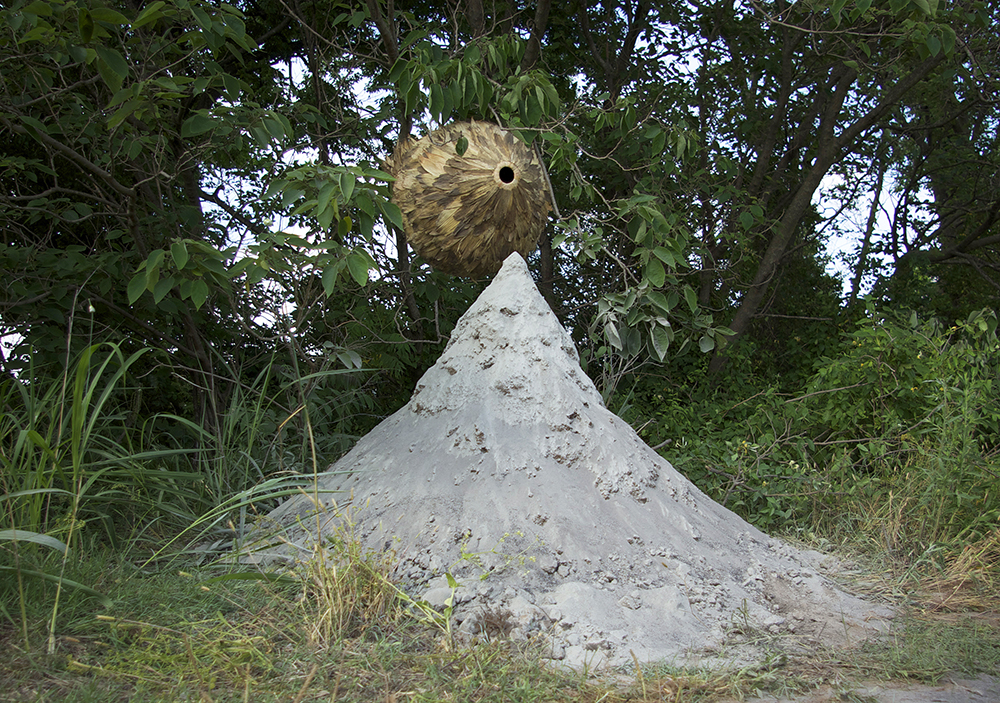 untitled (oven) , corn husks and grass, 26 x 43 x 21 inches
