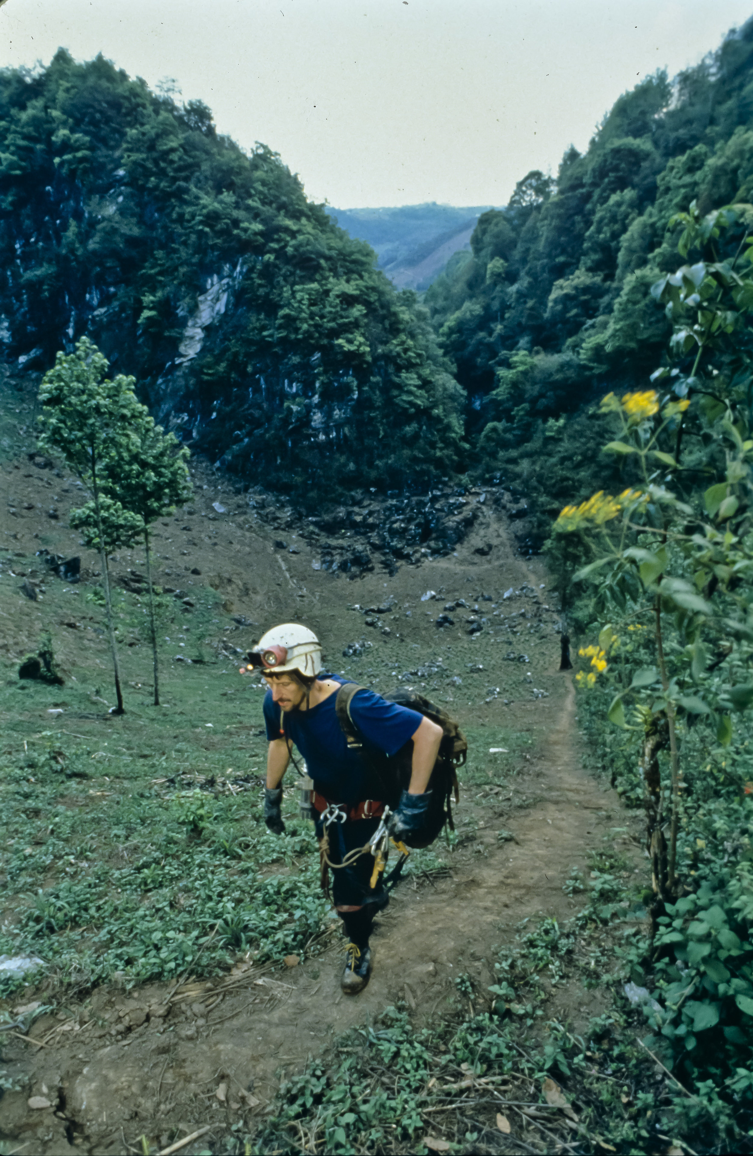 Bill Stone makes his way up the caver trail from the entrance of the Sotano de San Agustin to basecamp. Photo by U. S. Deep Caving Team/Wes Skiles.
