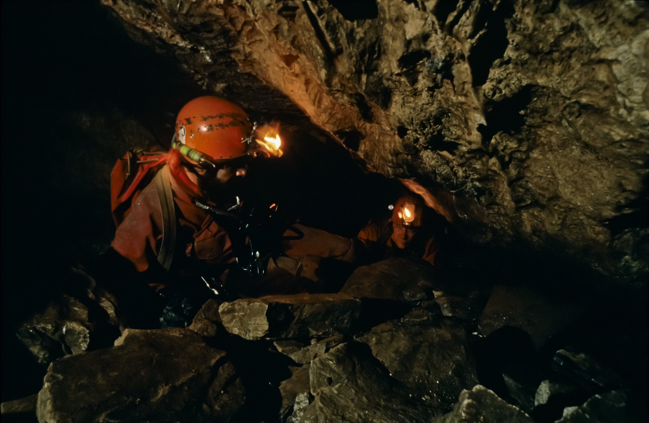 Shortly beyond the entrance shaft a new passage - the Fool's Day Extension, discovered by Mark Minton and Bill Steele in 1988 - leads to a series of constrictions. Photo by U. S. Deep Caving Team/Wes Skiles.